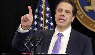 FILE - In this Monday, Jan. 9, 2017, file photo, New York Gov. Andrew Cuomo delivers one of his State of the State addresses in New York's One World Trade Center building. A nonprofit that has operated the beloved Milk Bar at New York's State Fair for 65 years is pulling out and blaming Cuomo. The group had hoped to double the longstanding 25-cent price for a cup of milk to meet its expenses. But it said Cuomo's administration not only blocked the price hike but failed to come through with a promised subsidy. (AP Photo/Richard Drew, File)