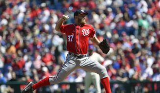 Washington Nationals starting pitcher Stephen Strasburg throws during the first inning of a baseball game against the Philadelphia Phillies, Sunday, April 9, 2017, in Philadelphia. (AP Photo/Derik Hamilton)