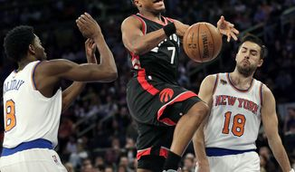 Toronto Raptors' Kyle Lowry, center, loses the ball on the way to the basket during the first half of an NBA basketball game against the New York Knicks, Sunday, April 9, 2017, in New York. (AP Photo/Seth Wenig)