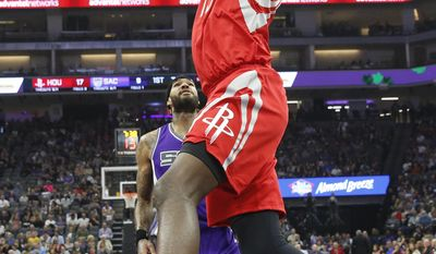 Houston Rockets center Clint Capela, right, stuffs over Sacramento Kings center Willie Cauley-Stein during the first half of an NBA basketball game, Sunday, April 9, 2017, in Sacramento, Calif. (AP Photo/Rich Pedroncelli)