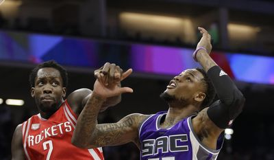 Houston Rockets guard Patrick Beverley, left, and Sacramento Kings guard Ben McLemore go for the rebound during the first half of an NBA basketball game Sunday, April 9, 2017, in Sacramento, Calif. (AP Photo/Rich Pedroncelli)