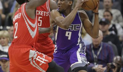 Sacramento Kings guard Langston Galloway, right, is trapped in the corner by Houston Rockets' Patrick Beverley, left, and Houston Rockets center Clint Capela, center, during the first half of an NBA basketball game, Sunday, April 9, 2017, in Sacramento, Calif. (AP Photo/Rich Pedroncelli)