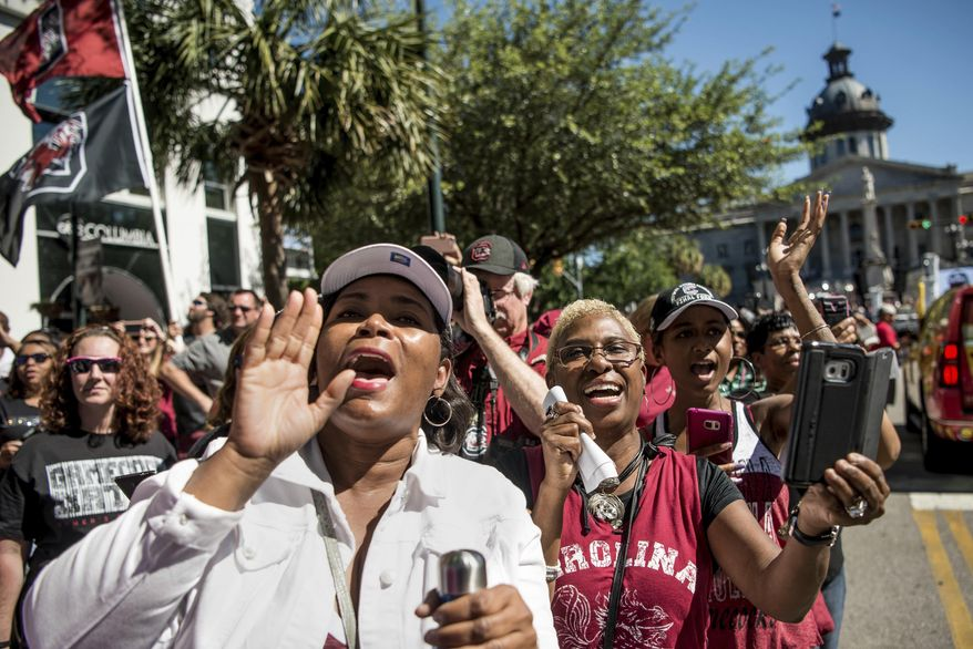 South Carolina fans cheer for their team during a parade honoring the South Carolina women's basketball National Championship title, Sunday, April 9, 2017, in Columbia, S.C. South Carolina defeated Mississippi State last Sunday to capture their first national title in the sport. (AP Photo/Sean Rayford)