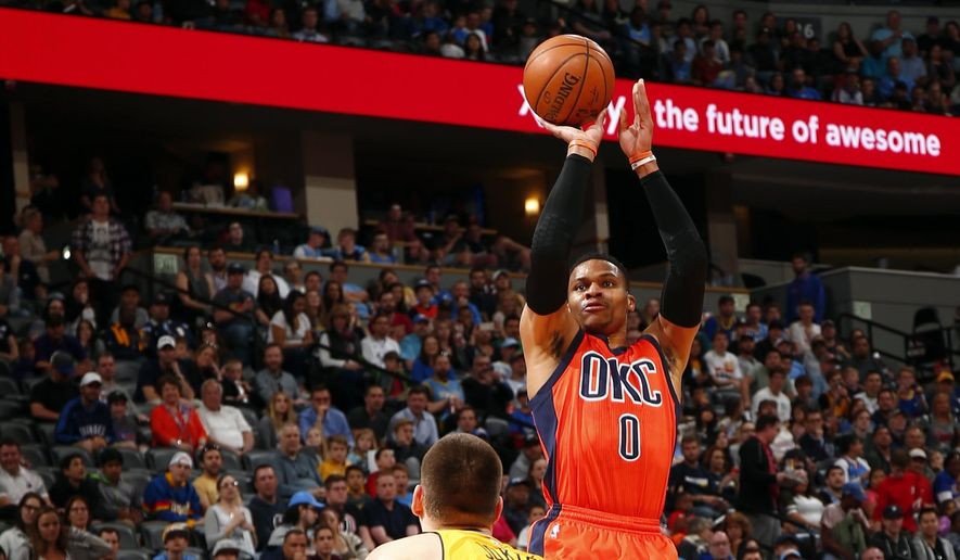 Oklahoma City Thunder guard Russell Westbrook takes a shot over Denver Nuggets forward Nikola Jokic (15) during the first half of a basketball game Sunday, April 9, 2017, in Denver. (AP Photo/Jack Dempsey)