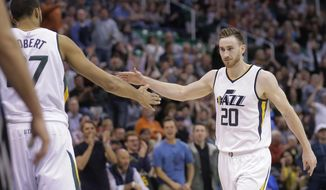 Utah Jazz's Gordon Hayward (20) receives a high-five from teammate Rudy Gobert, left, after scoring a 3-pointer against the Minnesota Timberwolves during the second half in an NBA basketball game Friday, April 7, 2017, in Salt Lake City. The Jazz won 120-113. (AP Photo/Rick Bowmer)