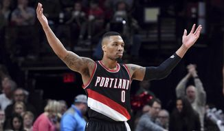 Portland Trail Blazers guard Damian Lillard acknowledges the crowd during the second half of the team's NBA basketball game against the Utah Jazz in Portland, Ore., Saturday, April 8, 2017. Lillard scored a franchise-record 59 points as the Blazers won 101-86. (AP Photo/Steve Dykes)