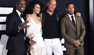 """Tyrese Gibson, from left, Nathalie Emmanuel, Vin Diesel and Ludacris attend the world premiere of Universal Pictures' """"The Fate of the Furious"""" at Radio City Music Hall on Saturday, April 8, 2017, in New York. (Photo by Evan Agostini/Invision/AP)"""