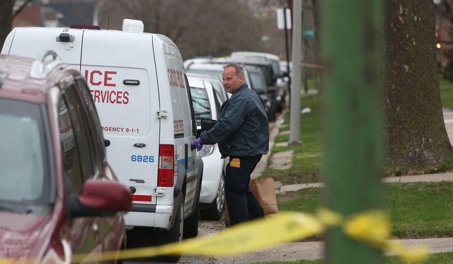 an investigator opens the door of a vehicle outside a home on the south side of chicago monday. Black Bedroom Furniture Sets. Home Design Ideas