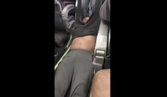 This Sunday, April 9, 2017, image made from a video provided by Audra D. Bridges shows a passenger being removed from a United Airlines flight in Chicago. Video of police officers dragging the passenger from an overbooked United Airlines flight sparked an uproar Monday on social media, and a spokesman for the airline insisted that employees had no choice but to contact authorities to remove the man. (Audra D. Bridges via AP)