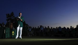 Sergio Garcia, of Spain, holds up his winning trophy at the green jacket ceremony after the Masters golf tournament Sunday, April 9, 2017, in Augusta, Ga. (AP Photo/Matt Slocum)