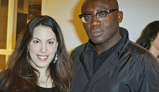 FILE - In this Tuesday, Jan. 24, 2012 file photo, fashion designer Mary Katrantzou, left, poses with magazine director Edward Enninful at a Longchamp cocktail party as part of the Haute Couture Fashion Week in Paris. British Vogue's search for a new leader has come to an end with the naming of Edward Enninful as the magazine's new chief editor, it was announced on Monday, April 10, 2017. He will be the first male editor of British Vogue. Enninful, who had been the creative and fashion director at W magazine, has been an influential magazine fashion director for more than 20 years. (AP Photo/Thomas Padilla, file)