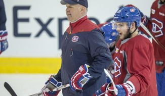 Montreal Canadiens' Alex Galchenyuk and head coach Claude Julien watch during a practice Monday, April 10, 2017, in Brossard, Quebec. The Canadiens will face the New York Rangers in the first round of playoffs. (Paul Chiasson/The Canadian Press via AP)