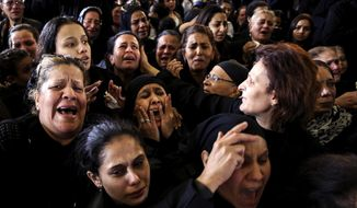 "Women cry during the funeral for those killed in a Palm Sunday church attack in Alexandria Egypt, at the Mar Amina church, Monday, April 10, 2017.  Egyptian Christians were burying their dead on Monday, a day after Islamic State suicide bombers killed at least 45 people in coordinated attacks targeting Palm Sunday services in two cities. Women wailed as caskets marked with the word ""martyr"" were brought into the Mar Amina church in the coastal city of Alexandria, the footage broadcast on several Egyptian channels. (AP Photo/Samer Abdallah)"