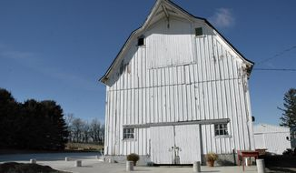 This Feb. 2, 2017 photo shows, Brad and Carla Miller's dairy barn that they transformed  along with the surrounding grounds into The Barn on the Hill, for weddings, rehearsals, showers, class reunions, anniversary and birthday parties in Leaf River, Ill. The Barn on the Hill features a large concrete patio around two sides of the barn to give guests flexibility for celebrations inside, outside, or both (Vinde Wells/Sauk Valley Media via AP)