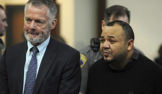 Oscar Hernandez, right, with his attorney John R. Gulash, faces Judge William Holden in Bridgeport Superior Court on charges he killed his girlfriend then fled with their 6-year-old daughter on Monday, April 10, 2017, in Bridgeport, Conn. (Ned Gerard/Hearst Connecticut Media via AP, Pool)