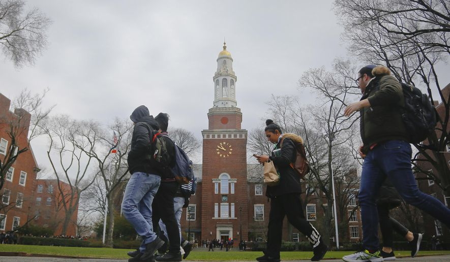 In this Feb. 1, 2017, file photo, Brooklyn College students walk between classes on campus in New York. The New York state Legislature approved a budget on April 9, 2017, that includes funding for Democratic Gov. Andrew Cuomo's plan to offer free tuition for middle-class students at state universities. (AP Photo/Bebeto Matthews, File)