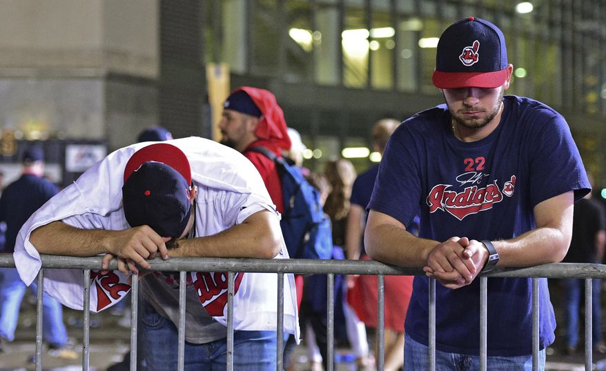 FILE - In this Nov. 3, 2016, file photo, Cleveland Indians fans Levi Jones, left, and Kyle Zabarsky react during a watch party, after Game 7 of the baseball World Series between the Indians and the Chicago Cubs, outside Progressive Field in Cleveland. Months have passed since the Indians' last home game, an epic, once-in-a-generation Game 7 that will forever be remembered as the night the Chicago Cubs ended a championship drought spanning 108 years. It's also the night Cleveland finished surrendering a 3-1 lead in the World Series. (AP Photo/David Dermer, File)