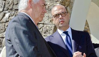 U.S. Secretary of State Rex Tillerson, left, and Italian Foreign Minister Angelino Alfano, talk to each other after laying a wreath at a memorial in Santa' Anna di Stazzema, a site of Nazi atrocities where 560 civilians, including some 130 children, were killed during World War II, Monday, April 10, 2017. Foreign ministers from the Group of Seven industrialized nations are gathering in Lucca for a meeting given urgency by the chemical attack in Syria and the U.S. military response, with participants aiming to pressure Russia to end its support for President Bashar Assad. (Riccardo Dalle Luche/ANSA via AP)