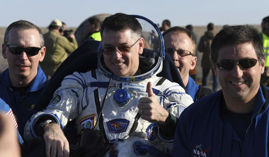 Ground personnel carry U.S. astronaut Robert Shane Kimbrough shortly after landing near Dzhezkazgan, Kazakhstan Monday, April 10, 2017, on the treeless Central Asian steppes Russia's Soyuz MS-02 space capsule carrying the International Space Station (ISS) crew of Andrei Borisenko and Sergey Ryzhykov of Russia and NASA astronaut Robert Shane Kimbrough landed in a remote area in Kazakhstan. (Kirill Kudryavtsev/Pool photo via AP)