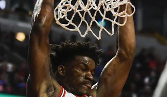 Chicago Bulls forward Jimmy Butler, left, dunks against the Orlando Magic during the second half of an NBA basketball game, Monday, April 10, 2017, in Chicago. (AP Photo/Matt Marton)