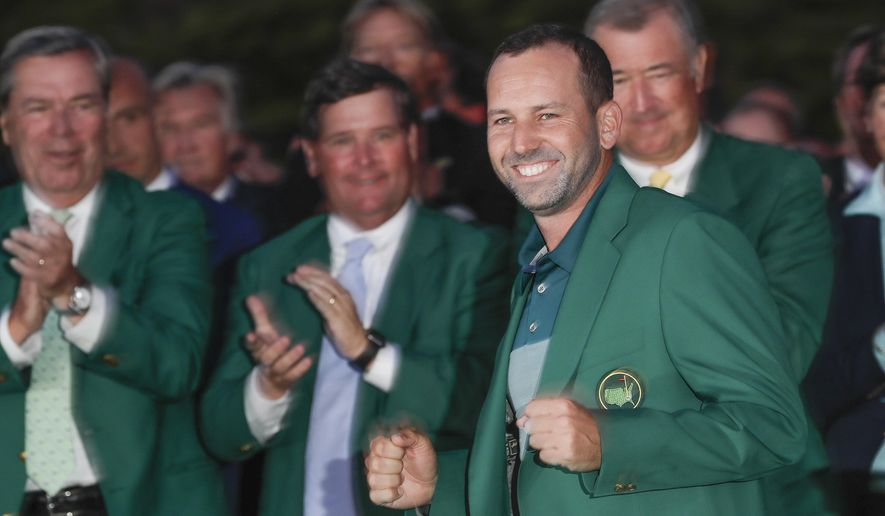 Sergio Garcia, of Spain, celebrates at the green jacket ceremony after the Masters golf tournament Sunday, April 9, 2017, in Augusta, Ga. (AP Photo/David J. Phillip)