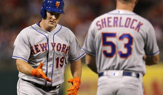 New York Mets' Jay Bruce (19) is congratulated by third base coach Glenn Sherlock (53) after hitting a home run in the eighth inning of a baseball game, Monday, April 10, 2017, in Philadelphia. The Mets won 4-3. (AP Photo/Laurence Kesterson)