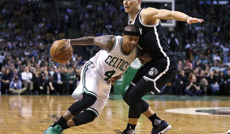 Boston Celtics guard Isaiah Thomas (4) tries to drive past Brooklyn Nets guard Jeremy Lin (7) during the second half of an NBA basketball game in Boston, Monday, April 10, 2017. Thomas scored 27 points as the Celtics defeated the Nets 114-105. (AP Photo/Charles Krupa)