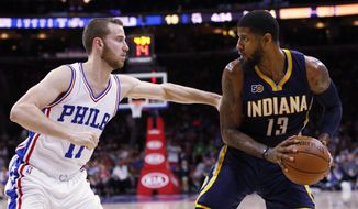 Indiana Pacers' Paul George, right, looks to make his move on Philadelphia 76ers' Nik Stauskas, left, during the first half of an NBA basketball game, Monday, April 10, 2017, in Philadelphia. (AP Photo/Chris Szagola)