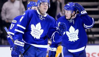 Toronto Maple Leafs center Auston Matthews (34) reacts to a goal, next to teammates Morgan Rielly (44) and Zach Hyman (11), during the third period of an NHL hockey game against the Toronto Maple Leafs in Toronto on Saturday, April 8, 2017. (Frank Gunn/The Canadian Press via AP)
