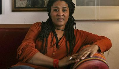 "FILE - In this April 2, 2009 file photo, playwright Lynn Nottage poses at home in New York. Nottage's play, ""Sweat"", was awarded the Pulitzer Prize for drama on Monday, April 10, 2017. (AP Photo/Bebeto Matthews, File)"