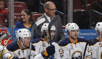 Buffalo Sabres head coach Dan Bylsma, center top, looks on during the second period of an NHL hockey game against the Florida Panthers, Saturday, April 8, 2017, in Sunrise, Fla. (AP Photo/Joel Auerbach)