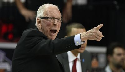 FILE - In this March 10, 2016, file photo, San Diego State coach Steve Fisher calls to his team during the second half of an NCAA college basketball game against Utah State at the Mountain West Conference men's tournament in Las Vegas. Two people with knowledge of the situation said Monday, April 10, 2017, that Fisher is retiring after spending 18 seasons as San Diego State's basketball coach. (AP Photo/David Becker, File)