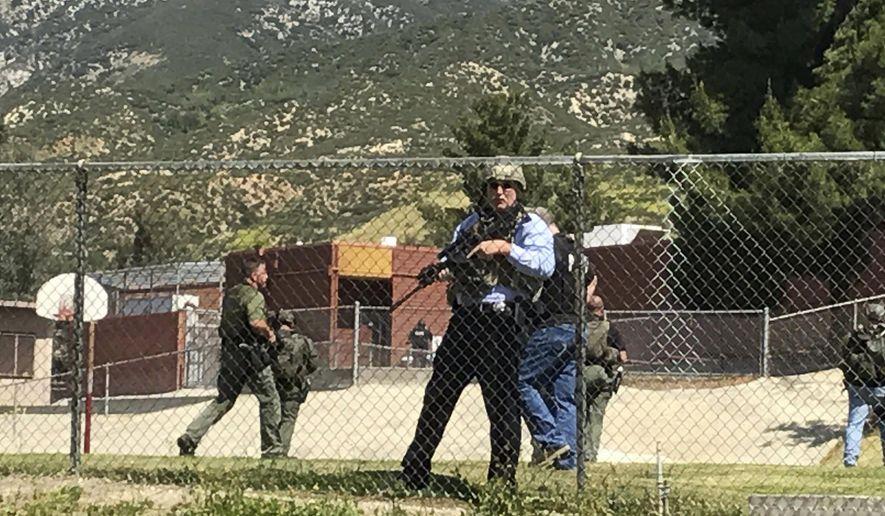 Emergency personnel respond to a shooting inside North Park School Elementary School on Monday, April 10, 2017, in San Bernardino, Calif. (Rick Sforza/Los Angeles Daily News via AP)