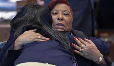 Rep. Pat Smith, D-Baton Rouge, gets a hug from Jada Delpit, granddaughter of Joe Delpit who served in the House for years ago, during opening day at the Louisiana legislature Monday April 10, 2017, in Baton Rouge, La. (Bill Fig/The Advocate via AP, Pool)