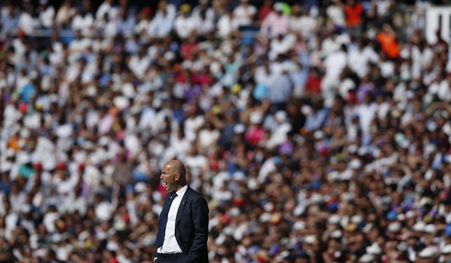 Real Madrid's head coach Zinedine Zidane shouts during a Spain's La Liga soccer match between Real Madrid and Alaves at the Santiago Bernabeu stadium in Madrid, Spain, Saturday, April 8, 2017. (AP Photo/Daniel Ochoa de Olza)