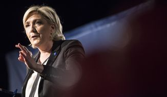 Far-right candidate for the presidential election Marine Le Pen speaks during a campaign meeting in Monswiller near Strasbourg, eastern France, in this Wednesday, April 5, 2017, file photo. (AP Photo/Jean-Francois Badias, file)