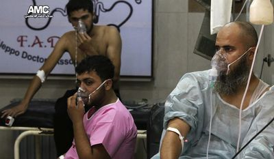 FILE - In this Tuesday, Sept. 6, 2016 file photo, provided by the Syrian anti-government activist group Aleppo Media Center (AMC), shows men breathing with oxygen masks inside a hospital in Aleppo, Syria. With its missile strike on Shayrat Airbase in central Syria, Washington signaled that it had judged President Bashar Assad responsible for the horrific chemical weapons attack in north Syria that drew international outrage last week. But it is not the first or even deadliest atrocity of the war.  (Aleppo Media Center via AP, File)