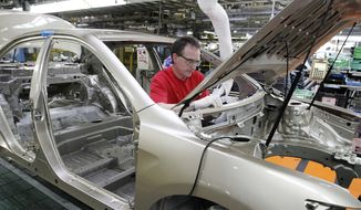 In this Feb. 25, 2010, file photo, production team member Darryl Ashley installs an inner dash silencer in a Camry on the assembly line at the Toyota Motor Manufacturing plant in Georgetown, Ky. Toyota said Monday, April 10, 2017, it is investing $1.3 billion to retool its sprawling Georgetown factory, where the company's flagship Camry sedans are built. No new factory jobs are being added, but Toyota says the upgrades amount to the biggest single investment ever at one of its existing plants in the United States. (AP Photo/James Crisp, File)