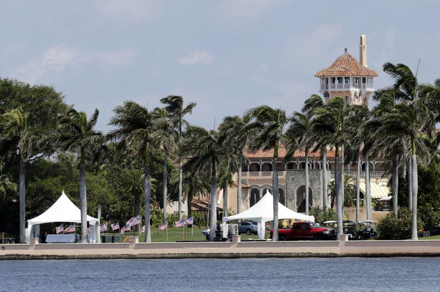 This Monday, April 3, 2017, file photo, shows the Mar-a-Lago resort in Palm Beach, Fla. Commissioners in Palm Beach County are so tired of spending money on President Donald Trump's frequent visits to his Mar-a-Lago resort, some are suggesting a special tax be levied against the property. Trump's visits have cost Palm Beach County taxpayers about $2 million. (AP Photo/Lynne Sladky, File)
