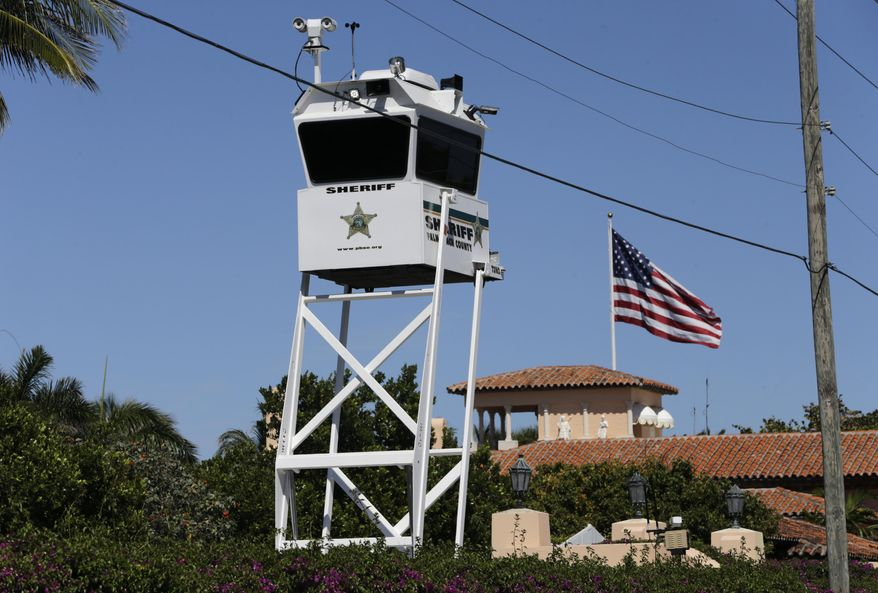 FILE - In this Friday, April 7, 2017, file photo, a Palm Beach County Sheriff's lookout tower sits outside of President Donald Trump's Mar-a-Lago resort, in Palm Beach, Fla. Commissioners in Palm Beach County are so tired of spending money on President Donald Trump's frequent visits to his Mar-a-Lago resort, some are suggesting a special tax be levied against the property. Trump's visits have cost Palm Beach County taxpayers about $2 million. (AP Photo/Lynne Sladky, File)