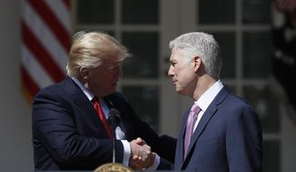 President Donald Trump shakes hands with Supreme Court Neil Gorsuch in the Rose Garden of the White House White House in Washington, Monday, April 10, 2017, following a public swearing-in ceremony.  (AP Photo/Carolyn Kaster) **FILE**