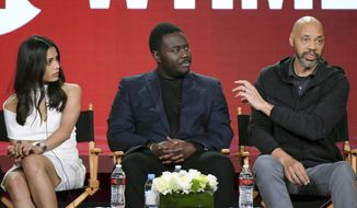 """FILE - In this Jan. 9, 2017 file photo, actors Freida Pinto, from left, Babou Ceesay and writer-producer John Ridley participate in the """"Guerrilla"""" panel at the Showtime portion of the 2017 Winter Television Critics Association press tour in Pasadena, Calif. Ridley said he expected his """"sharply political"""" TV miniseries """"Guerrilla,"""" about black rights activists in 1970s England, to be provocative. But the criticism he received at a London screening for the series' lack of a major black female character took him by surprise, he said Monday, April 10. (Photo by Richard Shotwell/Invision/AP, File)"""