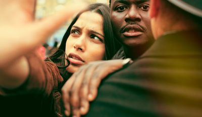 """This image released by Showtime shows Freida Pinto, left, Babou Ceesay in a scene from, """"Guerrilla,"""" written and produced by  John Ridley. Ridley said he expected his """"sharply political"""" TV miniseries """"Guerrilla,"""" about black rights activists in 1970s England, to be provocative. But the criticism he received at a London screening for the series' lack of a major black female character took him by surprise, he said Monday, April 10. (Showtime via AP)"""