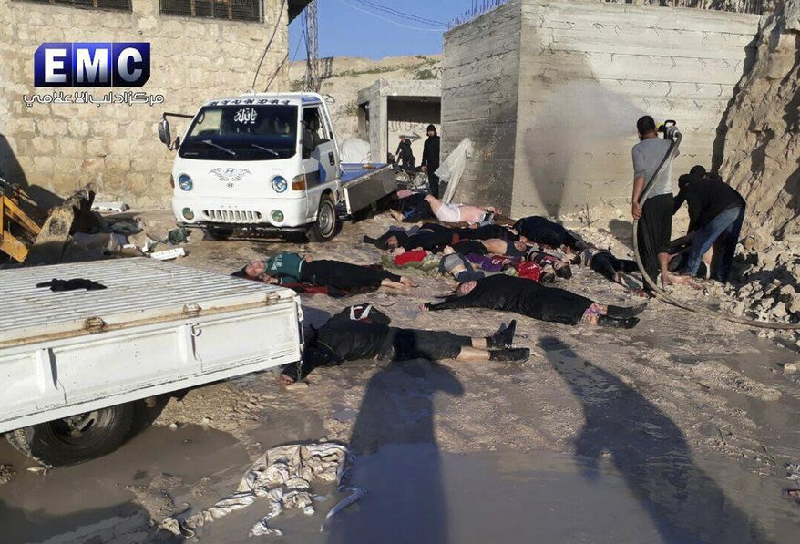 In his photo April 4, 2017m file photo, provided by the Syrian anti-government activist group Edlib Media Center, which has been authenticated based on its contents and other AP reporting, shows victims of a suspected chemical attack, in the town of Khan Sheikhoun, northern Idlib province, Syria. A senior U.S. official says the U.S. has concluded that Russia knew in advance of Syria's chemical weapons attack last week.  (Edlib Media Center, via AP)