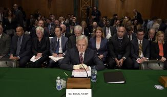 """FILE - In this Tuesday, Sept. 20, 2016, file photo, Wells Fargo CEO John Stumpf prepares to testify on Capitol Hill in Washington, before the Senate Banking Committee. In the results of an investigation released Monday, April 10, 2017, Wells Fargo's board of directors has blamed the bank's most senior management for creating an """"aggressive sales culture"""" at Wells that eventually led to the bank's scandal over millions of unauthorized accounts. The results of the investigation, conducted by the law firm Shearman & Sterling, also called for millions of dollars in compensation to be clawed back from former CEO Stumpf and community bank executive Carrie Tolstedt. (AP Photo/Susan Walsh, File)"""