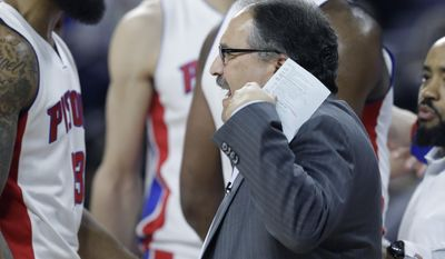 Detroit Pistons forward Marcus Morris (13) talks with head coach Stan Van Gundy during the first half of an NBA basketball game against the Washington Wizards, Monday, April 10, 2017, in Auburn Hills, Mich. (AP Photo/Carlos Osorio)