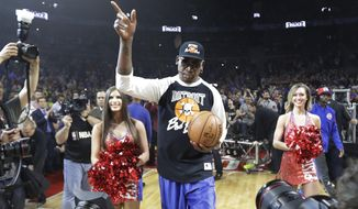 Former Detroit Pistons player Dennis Rodman delivers the game ball before the first half of an NBA basketball game against the Washington Wizards, Monday, April 10, 2017, in Auburn Hills, Mich. Rodman delivered the ball on the last Pistons game at The Palace before the team moves to downtown Detroit. (AP Photo/Carlos Osorio)