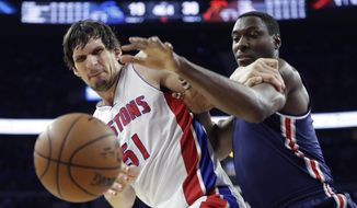Detroit Pistons center Boban Marjanovic (51) and Washington Wizards center Ian Mahinmi (28) reach for the rebound during the first half of an NBA basketball game, Monday, April 10, 2017, in Auburn Hills, Mich. (AP Photo/Carlos Osorio)