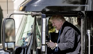 President Donald Trump pretends to drive as he gets in an 18-wheeler as he meets with truckers and CEOs regarding healthcare on the South Lawn of the White House, Thursday, March 23, 2017, in Washington. (AP Photo/Andrew Harnik)