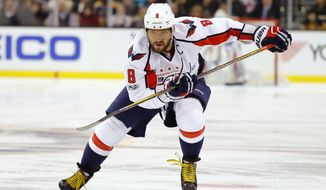 FILE - In this April 8, 2017, file photo, Washington Capitals' Alex Ovechkin skates during the third period of an NHL hockey game against the Boston Bruins, in Boston. With Ovechkin's ice time and Braden Holtby's workload down, the  Capitals are well-positioned for a Stanley Cup run. (AP Photo/Winslow Townson, File)